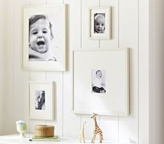 2 large, 1 small -White Gallery Frames one small and one large on one ledge, one on the other with object.