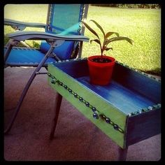 <3 Repurposed Dresser Drawer Into Patio Table decorated with gems for a little pizzazz