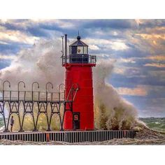 Wow! Can you feel the power of this wave as it crashes into the @VisitSouthHaven Lighthouse? This amazing shot was snapped by @180degreephotography on a turbulent Lake Michigan day. #PureMichigan #SouthHaven #LakeMichigan #Lighthouse