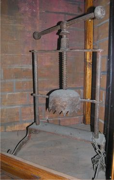 Ones head was put inside this and the screw was tightened squashing your head.