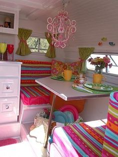 What an adorable lil trailer! I especially love the pink chandelier!