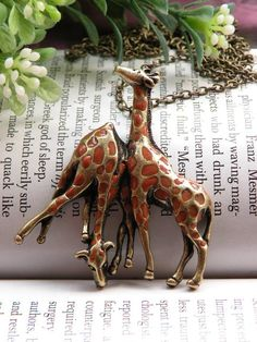 Pretty retro giraffe couples necklace pendant, jewelry vintage style. $4, via Etsy.