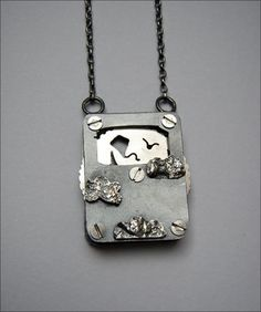 moving scene, birds and clouds  Materials: silver, steel nuts and bolts  Dimensions: 3x3.5cm  By Rebecca Kitching via Ganoskin