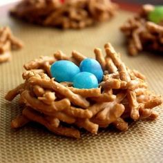 Bird's Nest Cookies - she mentions that she used butterscotch chips for a more realistic looking nest, but the combo of chocolate & peanut butter chips might like even more realistic.  :D   Mmmmmmmm!