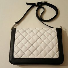 Leather Quilted Crossbody Bag Nwot in excellent condition,  black and white details/ red interior lining/ 100% leather, timeless and classic,like the bag but not the price; make an offer ili Bags Crossbody Bags
