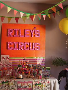 Love the circus sign...but I would use it as art over a bed with no head board or maybe over a low dresser.