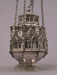 Switzerland, made in Basel, before Image 1 of Censer. Silver, raised and cast. The lowest of the three elevations is composed of eight pairs of tall, doubled windows surmounted by quatrefoils and a crocketed gable. Catholic Religion, Catholic Art, Religious Art, Antique Oil Lamps, Vases, Gothic Furniture, Gothic House, Victorian Art, Art For Art Sake