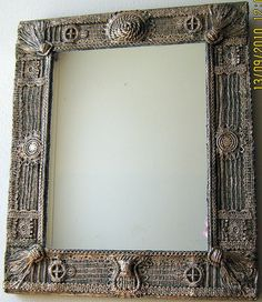 Mirror frame made with textured fabrics, lace and string...