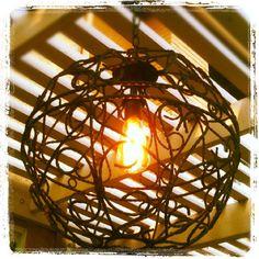 Hanging garden baskets repurposed to patio lighting!