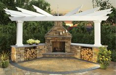 This Cambridge Pavingstones with Armortec outdoor fireplace is paired with a 2-Column fan pergola, also from Cambridge Pavingstones with Armortec.