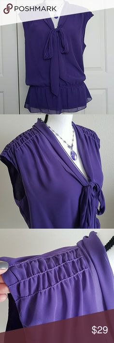 NWT Studio M Bow Peplum Blouse SZ Large NEW Sleeveless peplum blouse, Polyester, Hand Wash, Slight shawl-collar, V Neckline, Pullover Style,  Self Tie Bow at Center neckline, Ruched at shoulders, Elastic Inset at waist. Color: Purple Studio M Tops Blouses
