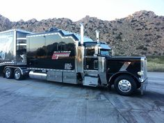 Big Pete with loads of room... take the family along for the ride, if you like, cause you ain't gonna get much freight on, hauling around that kinda weight! LOL!!!