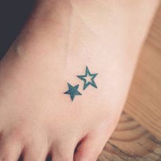 Foot tattoo of two stars by Seoeon.