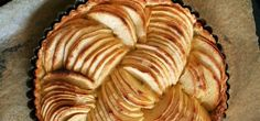 Tarte aux Pomme is a beautiful French apple tart that will leave your guests begging for more. It's made with finely sliced apples spiralled on a puff pastry base and can be served warm. Impress your friends and family at a dinner party with this recipe! Apple Tart Recipe, Apple Pie Recipes, Tart Recipes, Pastry Recipes, Just Desserts, Delicious Desserts, Yummy Food, French Desserts, Apple Desserts