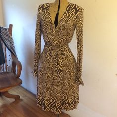 Diane von Furstenberg Heracles Wrap Dress Diane von Furstenberg Heracles 100% Silk Wrap Dress, brown and tan colors, long sleeved with unique tie cuffs, has two side pockets, approximately 42 inches from back to bottom hem, preowned condition, just dry cleaned, no tears or stains Diane von Furstenberg Dresses Long Sleeve