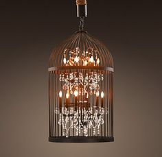 Birdcage + chandelier = WANT. Of course, I'd prefer brushed stainless or dark wrought iron... anything silvertoned instead of bronze-y brassy goldish.