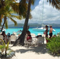Soggy Dollar Bar on Jost Van Dyke, BVI... home of the infamous Painkiller... drinking one right now and missing sitting under this exact palm tree and enjoying the view with my painkiller in hand... sigh....