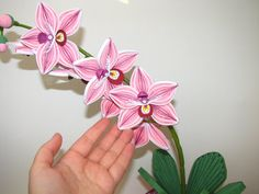Quilling art Pink Orchid Floral decorations Flower decorations Orchid bouquet…