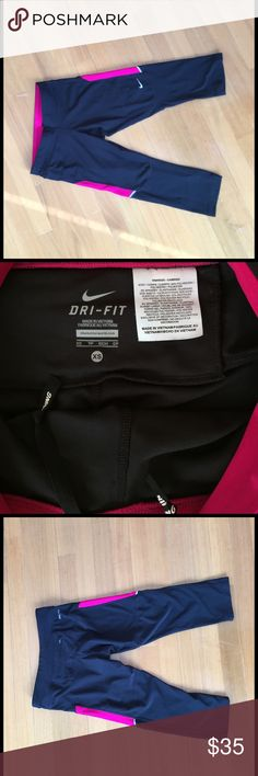 Nike drifit leggings. Nike drifit leggings. X-small. Black with pink on sides. Pocket in back for key. Great condition. Not full length - up to knee. Nike Pants Leggings