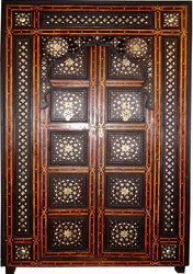 A gorgeous Moroccan door! Made from reclaimed cedar, all hand carved, masterfully adorned with raised three dimentional brass carvings and finely embellished with two tones camel bones and aged in an antique finish Moroccan Doors, Moroccan Home Decor, Moroccan Furniture, Moroccan Design, Pooja Room Door Design, Indian Doors, Pooja Rooms, Backyard Patio Designs, Room Doors