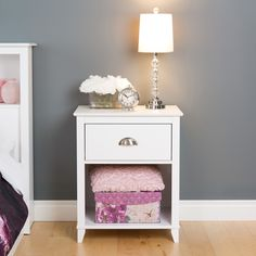 Craft the perfect room with this one drawer table. The 28 inch height makes for a piece that will work as a nightstand, while the sleek design ensures…