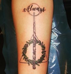 "The Deathly Hallows, with Hermione's wand, beautiful greenery, and, of course, ""Always."""