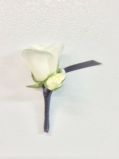 White rose magnetic boutonniere with black satin wrap from Seasonal Celebrations.