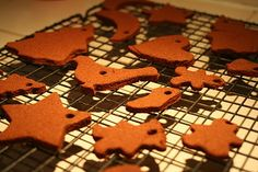 Cinnamon Ornaments: Mix 1 cup + 2 tablespoons of cinnamon with 3/4 cup applesauce until dough forms. You'll have to use your hands at the end. Roll out between 2 sheets of saran or parchment paper until about 1/3 inch thick. Cut with cookie cutters and use a straw to punch holes for the ribbon. Bake at 200 degrees for 2 1/2 hours.