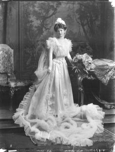 Miss Mona House in court dress, 1904