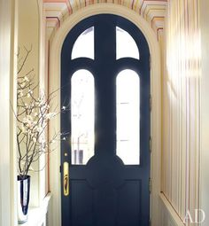 Artisan Mark Giglio painted the entrance hall with colorful stripes.