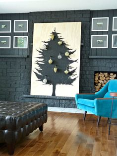How to Build a Scandinavian-Inspired DIY Plywood Christmas Tree // a cute alternative to the traditional Christmas tree, OR make a smaller one for atop a credenza for displaying some special ornaments.