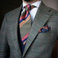 Add color to the classic suit with the right tie.