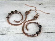 """♦ Hammered Copper Earrings, Smokey Quartz Earrings, Antiqued Copper Wire Wrapped Earrings, Handmade In USA. These earrings look fantastic! Great for any occasion or everyday wear. Eco-Friendly 14-gauge Copper Earrings securely wire wrapped with 20-gauge copper wire. Antiqued to a rich warm patina.  ♦ Earrings measure 1-5/8"""" long from ear wires by 1-1/4 diameter or wide. See Customer feedback: ♥ (Example) ♦ Very happy with my purchase. Great service! Would definitely shop here again.  ♦ Price…"""