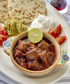 "If there is such a thing as Mexican soul food, this is it - carne con chile colorado, literally ""meat with red-colored chile sauce."" For this year's Cinco de Mayo celebration, honor the true spirit. Mexican Cooking, Mexican Food Recipes, Mexican Red Sauce Recipe, Dessert Recipes, Ethnic Recipes, Mexico Food, Comida Latina, Mexican Dishes, I Love Food"