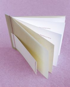 This ceremony program is easy to make if you start by purchasing a booklet that is preassembled but not bound (ours is made of a vellum cover over green paper, with white pages inside). Print your text on the pages, then secure the book, as well as a card printed with the names of the bride and groom, using a sewing machine's zigzag stitch.