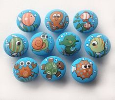 Items similar to Underwater / Ocean (Fish, Turtle and more) Drawer Pulls / Dresser Knobs and Pulls Hand Painted for Boys, Girls, Kids, Nursery Rooms on Etsy Rock Painting Patterns, Rock Painting Designs, Paint Designs, Pebble Painting, Pebble Art, Stone Painting, Painted Rock Animals, Hand Painted Rocks, Posca Art