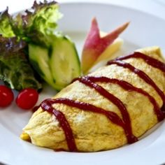 Classic Japanese Yoshoku recipe, savory chicken ketchup fried rice wrapped in a thin layer of egg.