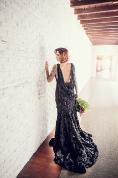 We die for this dark wedding dress.