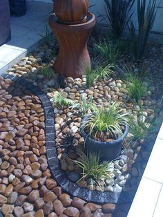 landscaping with stone- I like the use of different stones and brick