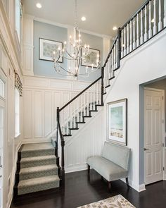 Love the stairs Foyer Paint Color. The paint on the upper wall insets is Sherwin Williams Samovar Silver. The paint on the lower walls is Accessible Beige and the trim is Cottonwhite. Mary Cook Associates Inc. Foyer Paint, House Design, House, Interior, Foyer Paint Colors, Luxury Homes, New Homes, House Interior, Interior Design