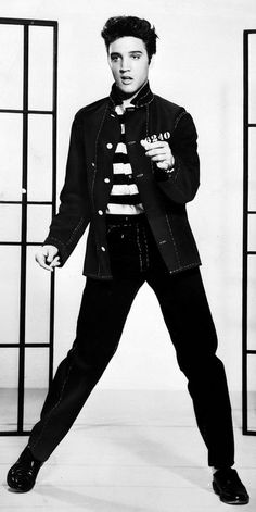 Black-and-white promotional photograph of Elvis Presley from the 1957 film Jailhouse Rock. American singer Elvis Presley featured in the decade-end singles chart with four songs.