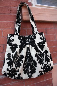Found this on someone's blog, it's a purse they made, but there are no instructions there...I love it though.  Oh geez, now I want to start sewing?!?!  What is up with me?  LOL
