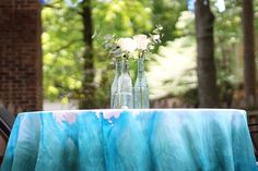 I have been wanting to make a dip-dyed tablecloth for at least a year, and felt that the birthday party was the perfect opportunity to try it out. Even though I've seen them everywhere, ther…