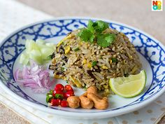 Recipe for Thai olive fried rice with YouTube video demonstration.