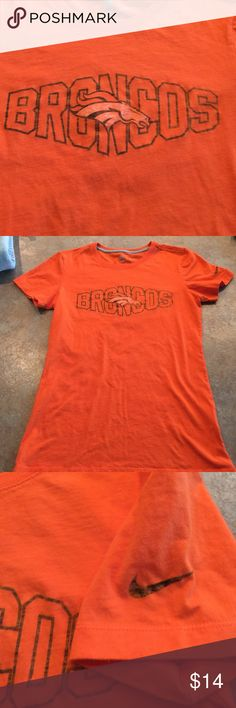 Denver Broncos Nike t-shirt Women's small Nike official team NFL Denver Broncos t-shirt, excellent condition, made to look like the printing is well worn but the shirt is like new, non smoking home Nike Tops Tees - Short Sleeve
