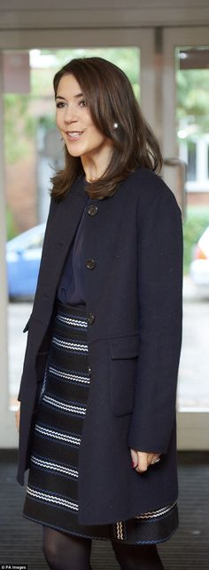 Stylish: Mary wore a knee-lengthstriped woven skirt by Chloe paired with a navy trench