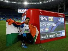 Devendra Jhajharia poses for the pictures next to the scoreboard that shows his…