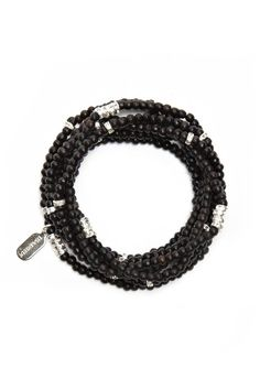 Set of 8 ebony and crystal stretch bracelets.