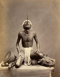 Juggler performing sword swallowing, India, 1880's