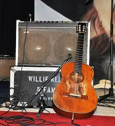 "Willie Nelson, Martin N-20. Possibly the most recognized guitar in country music. One wonders how the bridge has stayed on all these years. Nelson paid only $750 for it and named it ""Trigger."" Has refused to have it fixed for fear it will ruin the sound."